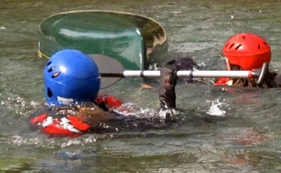 Swimming a Capsized Canoe